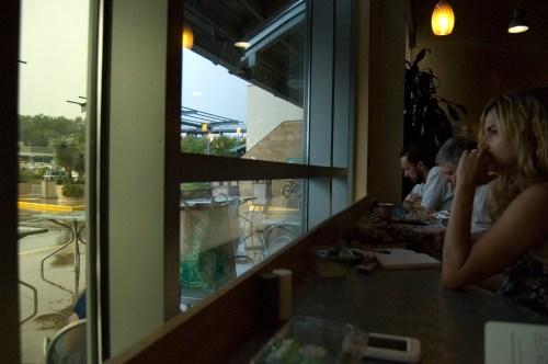 people watching the rain