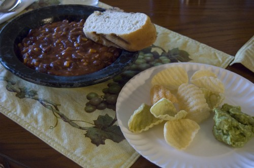 the finished dinner... chili, grill bread & chips with guac. incredible!