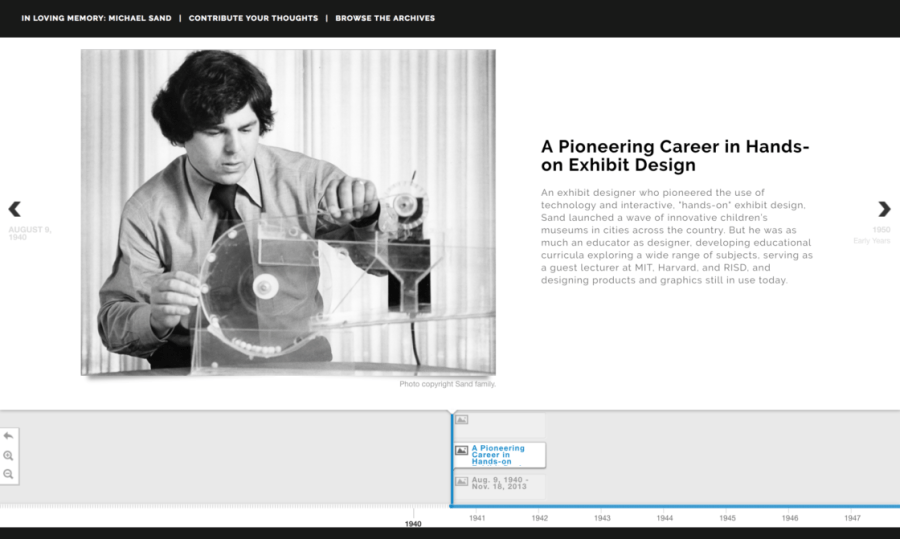 Screenshot of michaelsand.com shows a black-and-white photo of Michael working with a mechanical prototype. A text description to the right describes his role in the museum design field. A timeline navigation tool with dates spans the bottom of the image.