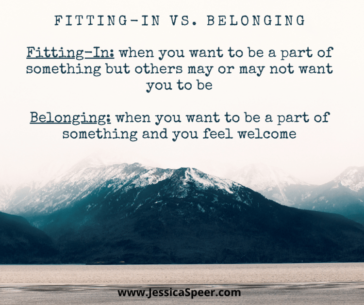 Image of mountain with definitions of fitting in versus belonging (definitions also shared in post)