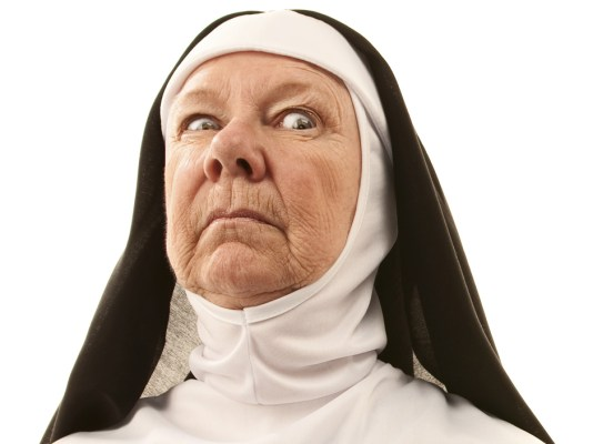 Local Input~ FOR NATIONAL POST USE ONLY - NO POSTMEDIA - Angry senior nun brandishing ruler as weapon. Credit: Thinkstock/ Getty.