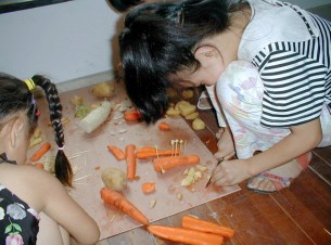 The Family Art Project, Li Min School (making airplanes out of veg), Island 6, Shanghai, 2006