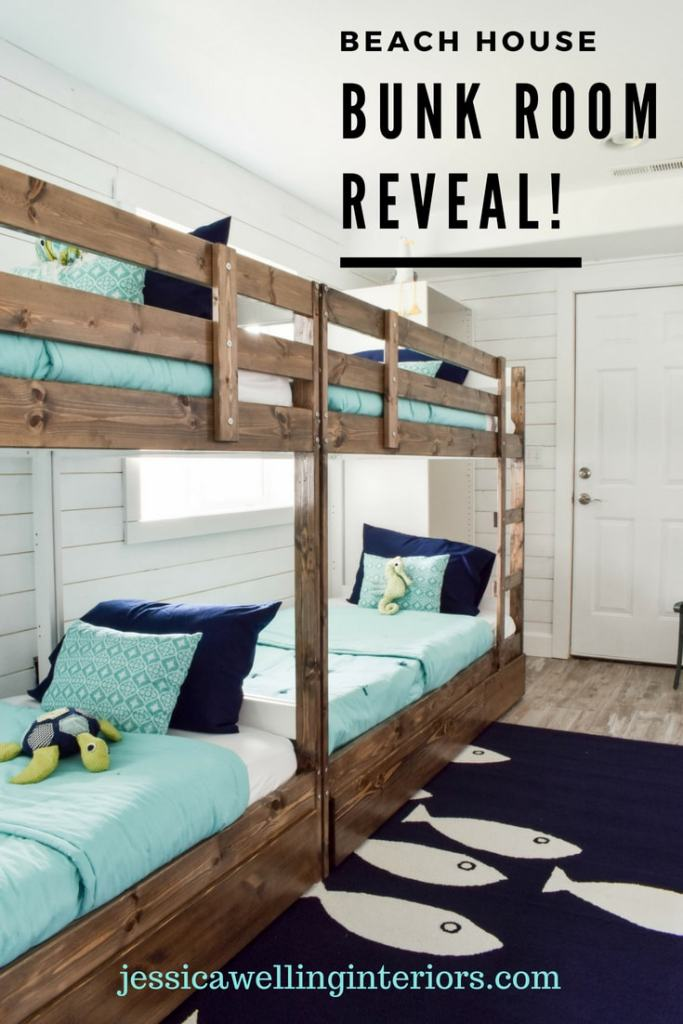 Beach House Bunk Room Reveal! image of 4 bunk beds with aqua colored bedding and a navy blue fish rug