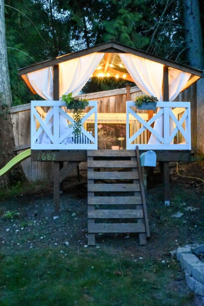 photo of playhouse with string lights
