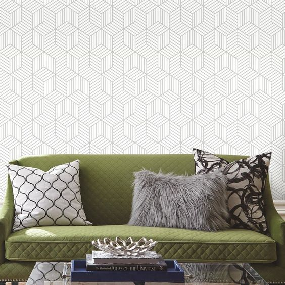 photo of white wallpaper with grey geometric print and green sofa