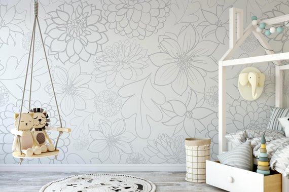 photo of light grey wallpaper with large floral pattern in child's bedroom