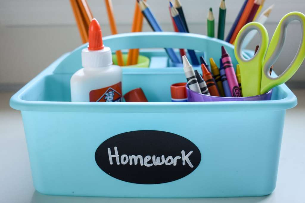 photo of homework caddy with crayons, pencils, glue, scissors, and colored pencils