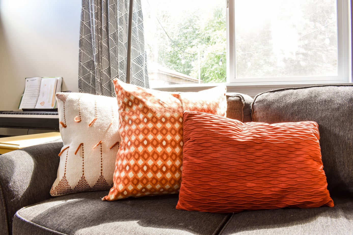 photo of cozy Fall throw pillows on sofa