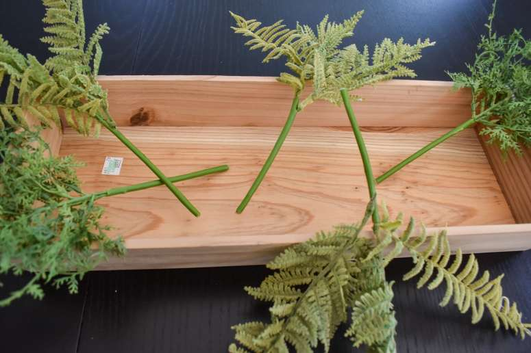 photo of wood tray with foliage for Fall centerpiece