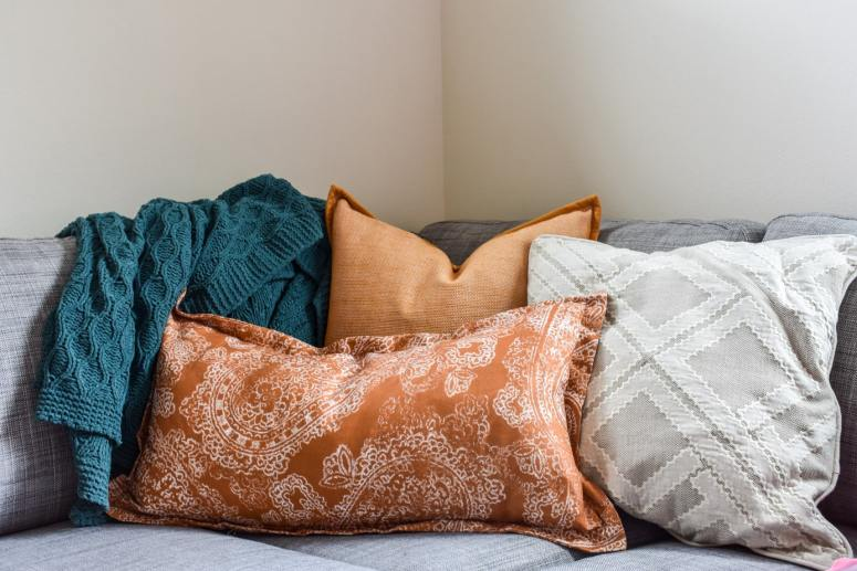 photo of cozy Fall throw pillows and blanket