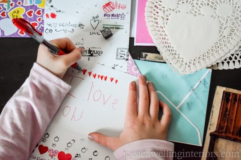 image of child making valentines in play post office