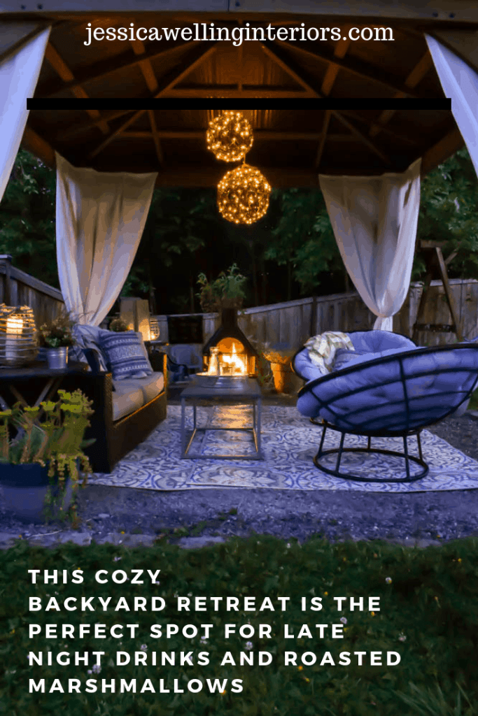 Image of gazebo covered outdoor living room with fireplace, cozy modern furniture, and an outdoor rug