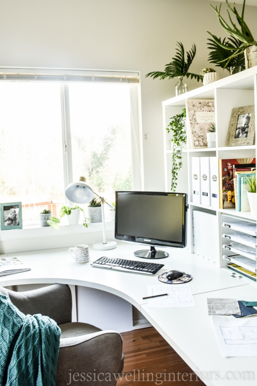 This budget-friendly Ikea home office makeover features a large workspace and plenty of bookshelf storage.