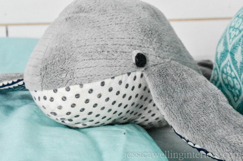 homemade stuffed whale on a bunk bed