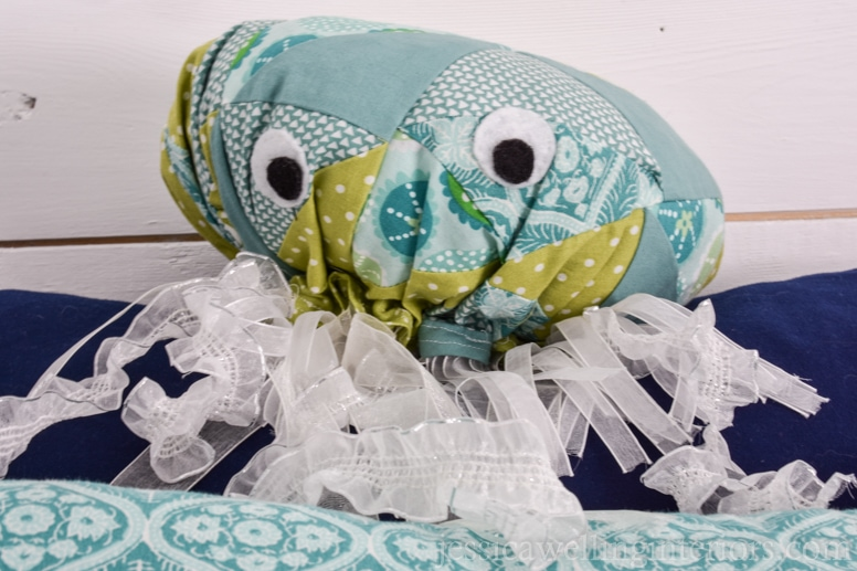 homemade stuffed jellyfish toy on a child's bunk bed