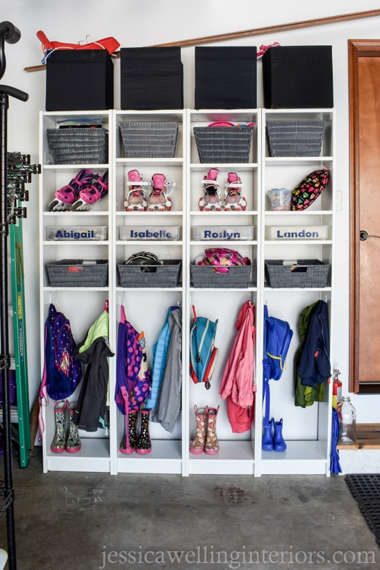 four skinny Billy bookcases from Ikea lined up to make a mudroom backpack storage system