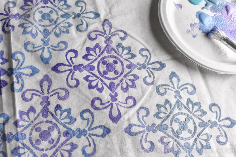 white fabric painted with ombre purple and blue paint in Moroccan tile stencil pattern