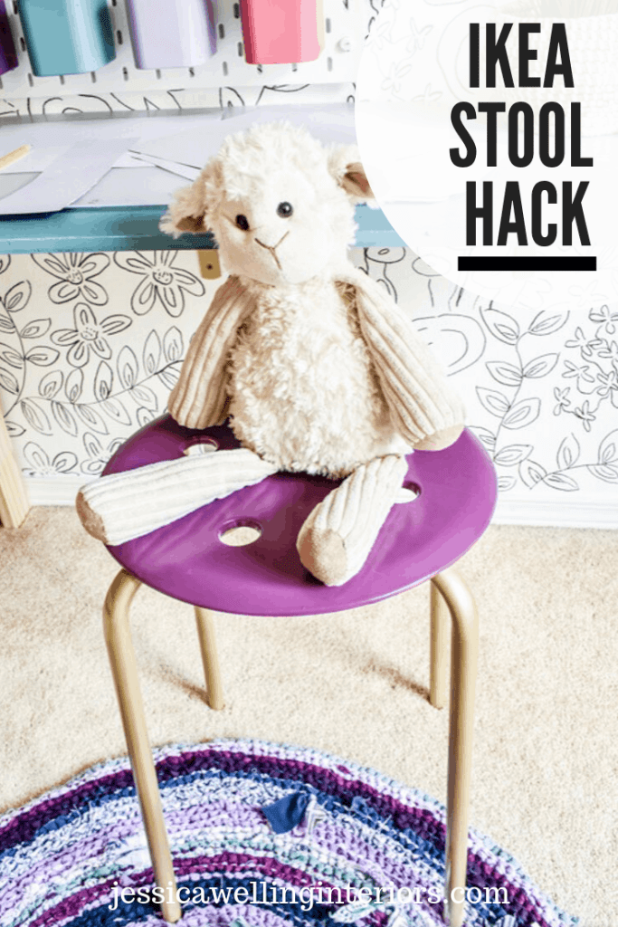 Ikea Stool Hack: Ikea Marius stool painted purple and gold with a stuffed lamb sitting on it