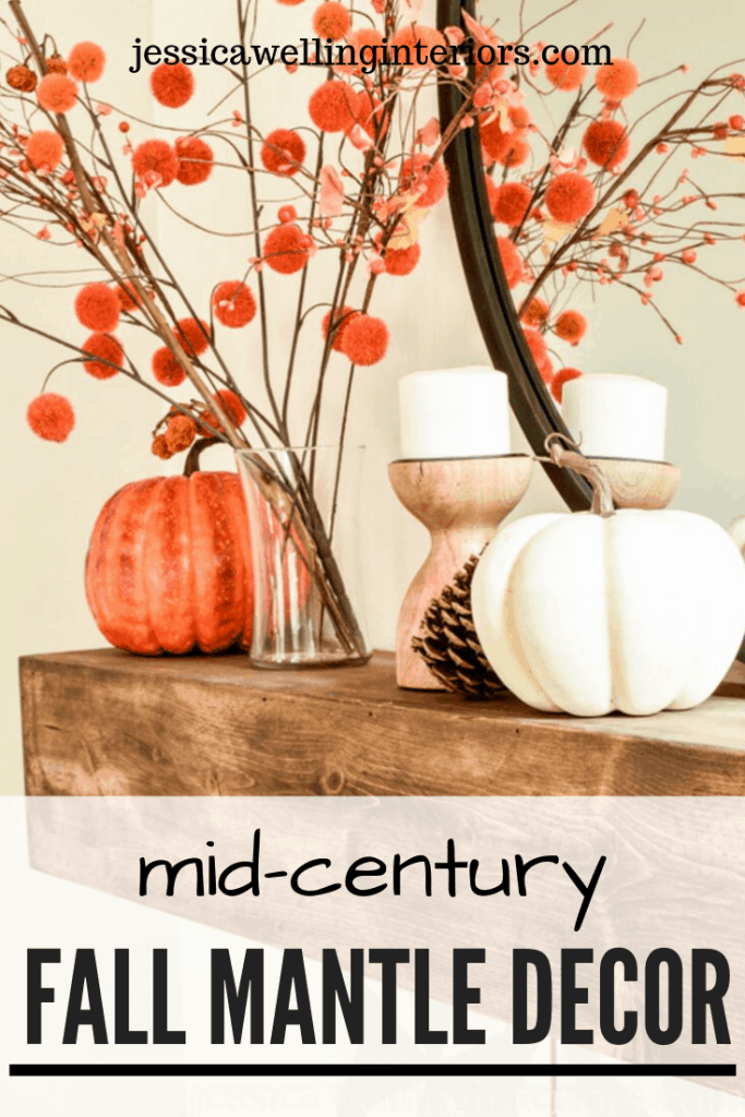 Mid-Century Fall Mantle Decor: wood mantel with orange pom-pom stems in a vase and pumpkins
