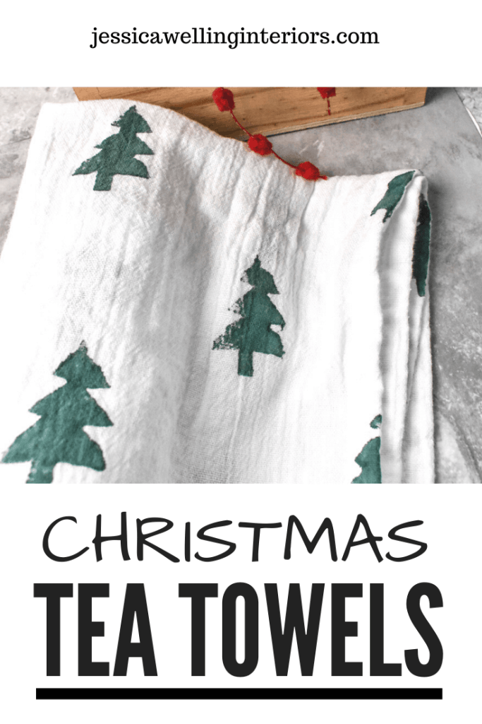 Christmas Tea Towels: white tea towel stamped with green Christmas trees sitting on tile