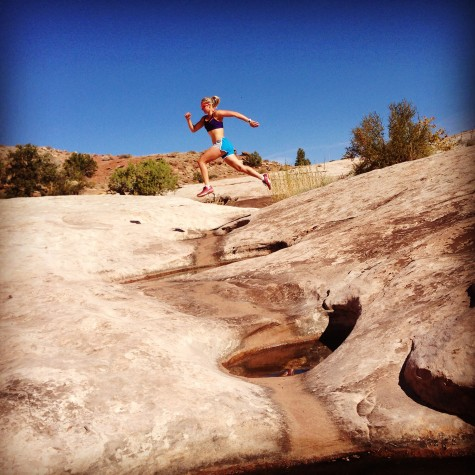 Hopping over the small pools of water we found on the slick rock (photo by Erika)