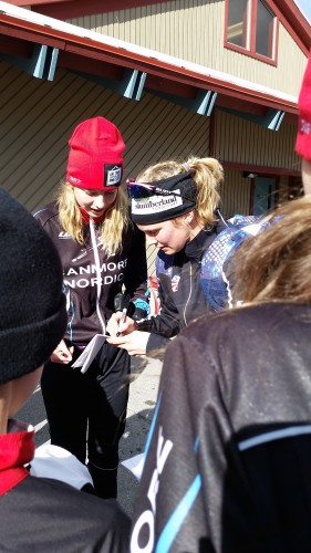 Signing hats and posters and bibs after the races!