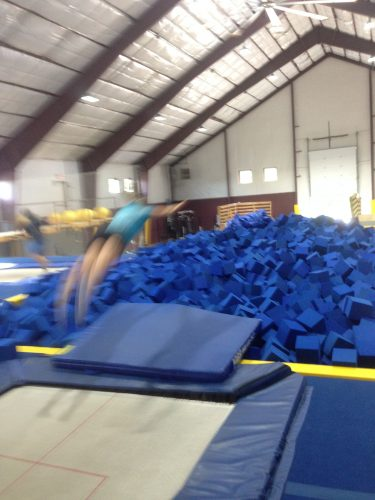 Taking a dive into the foam pit after balance training on the trampolines at the SMS air awareness center. (photo from Cork)