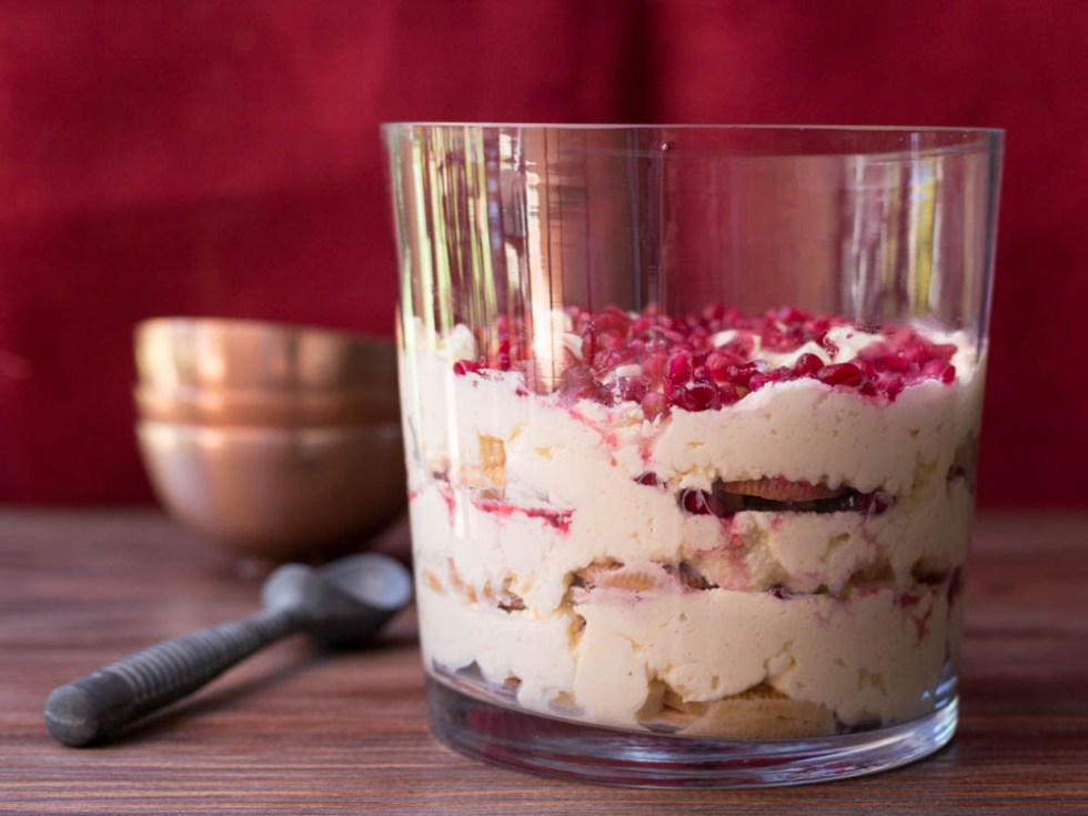 A golden oreo and pomegranate tiramisu, studded with chunks of white chocolate.