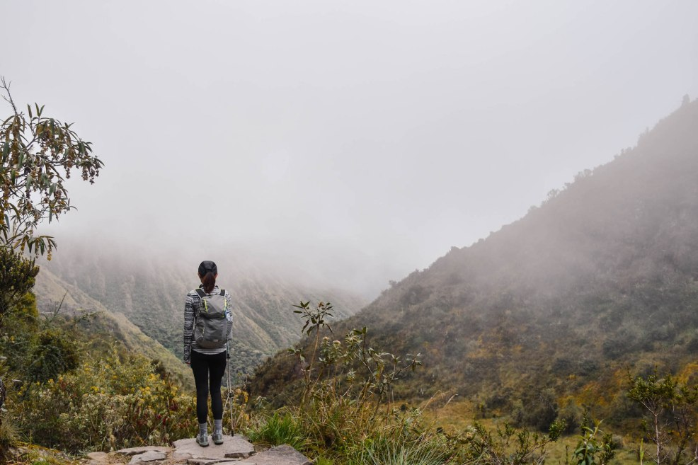 girl hiking the Inca trail to Machu Picchu in fog