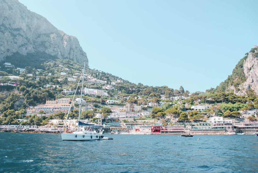 sailing around the coastline of Capri island Italy