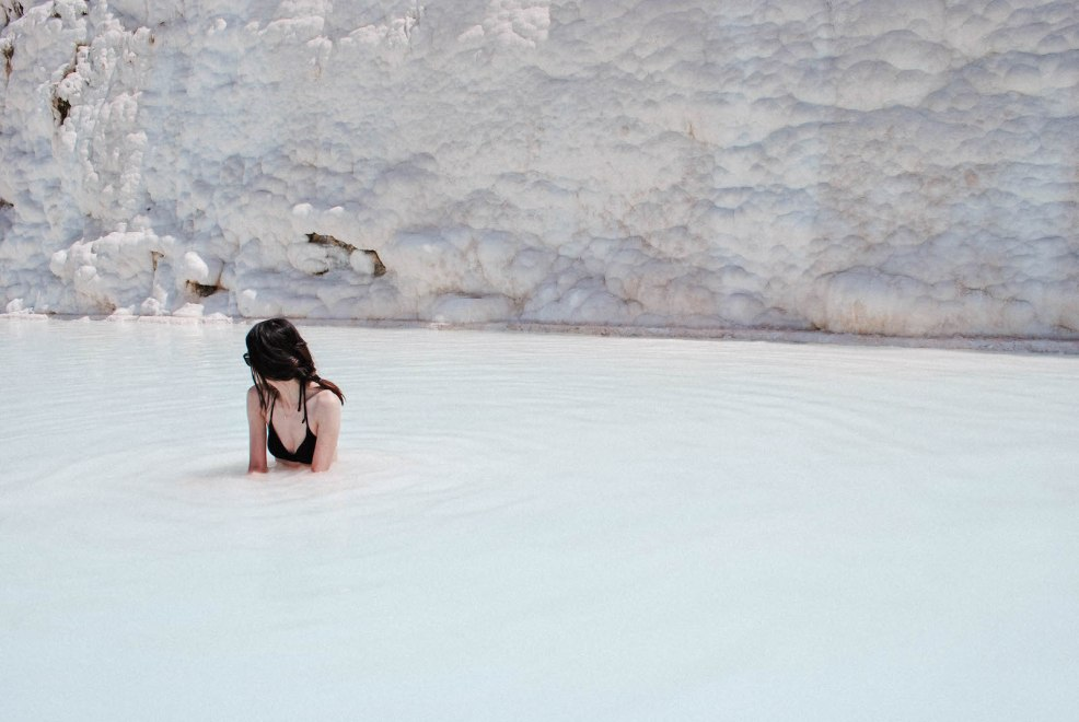 dipping in a pool at the pamukkale travertine terraces in turkey