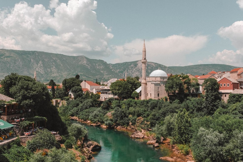 The Koski Mehmed Pasha Mosque sits along the Neretva River in Mostar