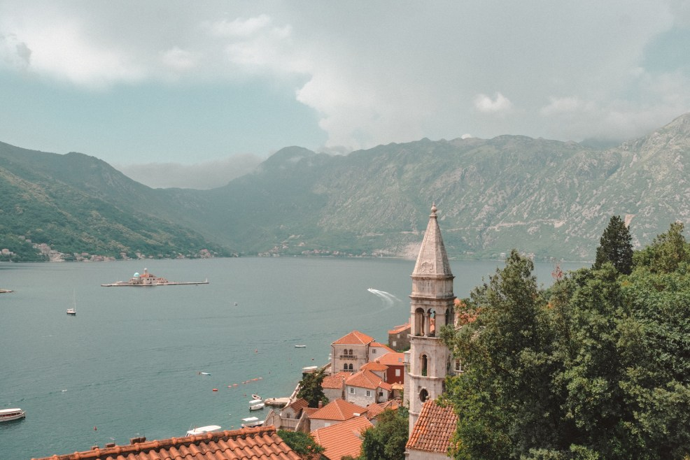 View of Perast and small islet Our Lady of The Rocks