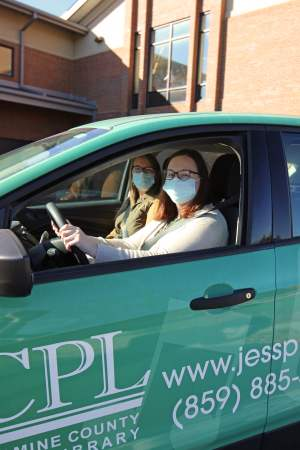Children's Outreach Librarians pictured in a JCPL vehicle.