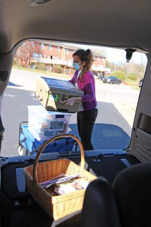 The Adult Outreach Librarian loading books into a JCPL van.
