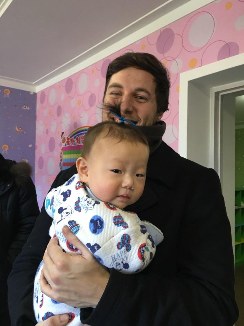 Josh holding a baby boy