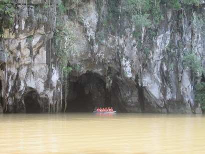 A boat just outside the entrance to the Underground River