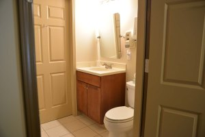 There are 2 bathrooms, each shared between 2 of the bedrooms. A third restroom is located near the dining room.