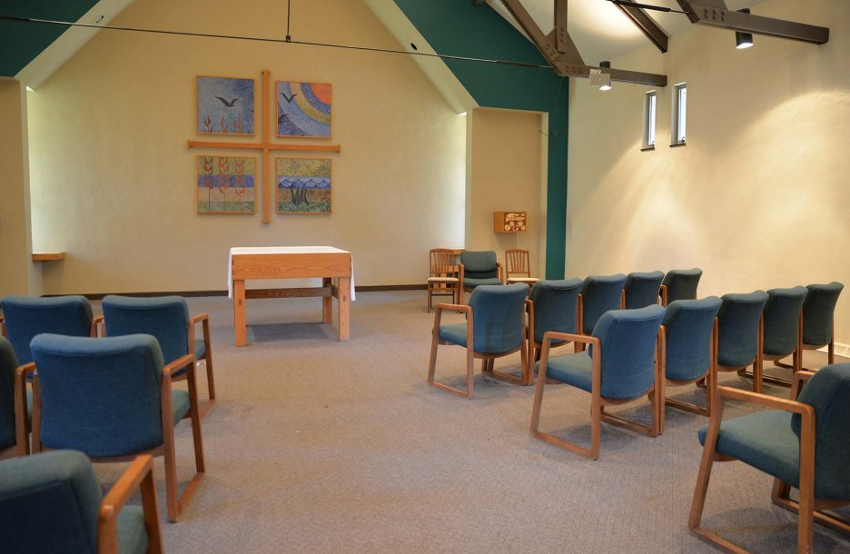 This is the chapel located at the rear of the building. The sacristy is located in the back right corner. There is a microphone and audio system available for groups to use.