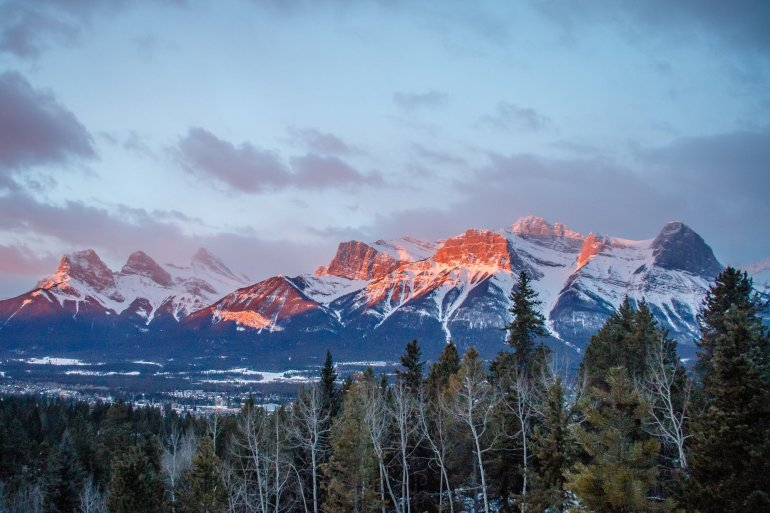 View of snowy mountain peaks from Canmore.