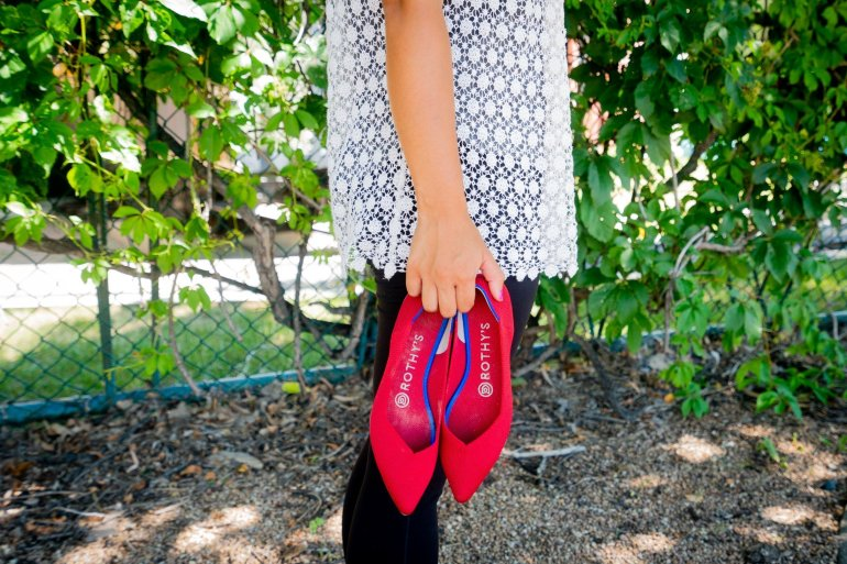 Rothy's Shoes Review - Me holding my Rothy's red flats!