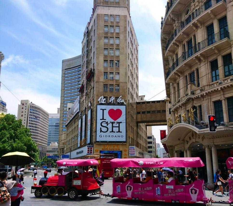 I love Shanghai sign and train for kids. Shopping on Nanjing Street