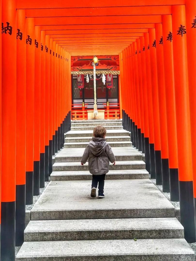Baby walking through shrines in Japan