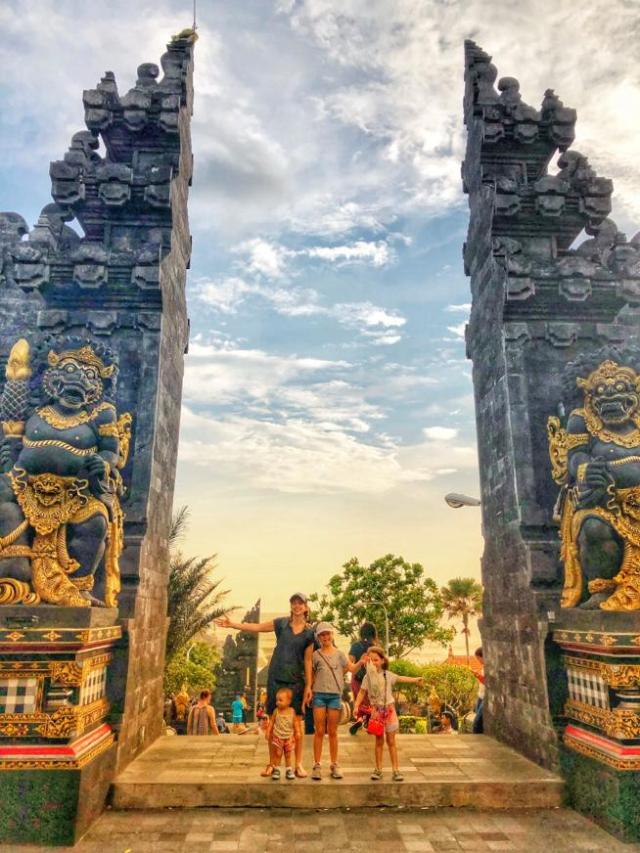 Standing in front of the iconic bali gate at the Tanah Lot Temple Entrance