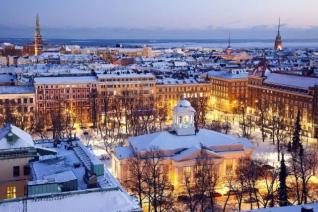 Buildings in Helsinki Finland at night with snow on top of the buildings