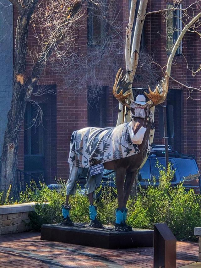A statue of a moose wearing a mask showing Park City is one of the safest places to travel after the coronavirus