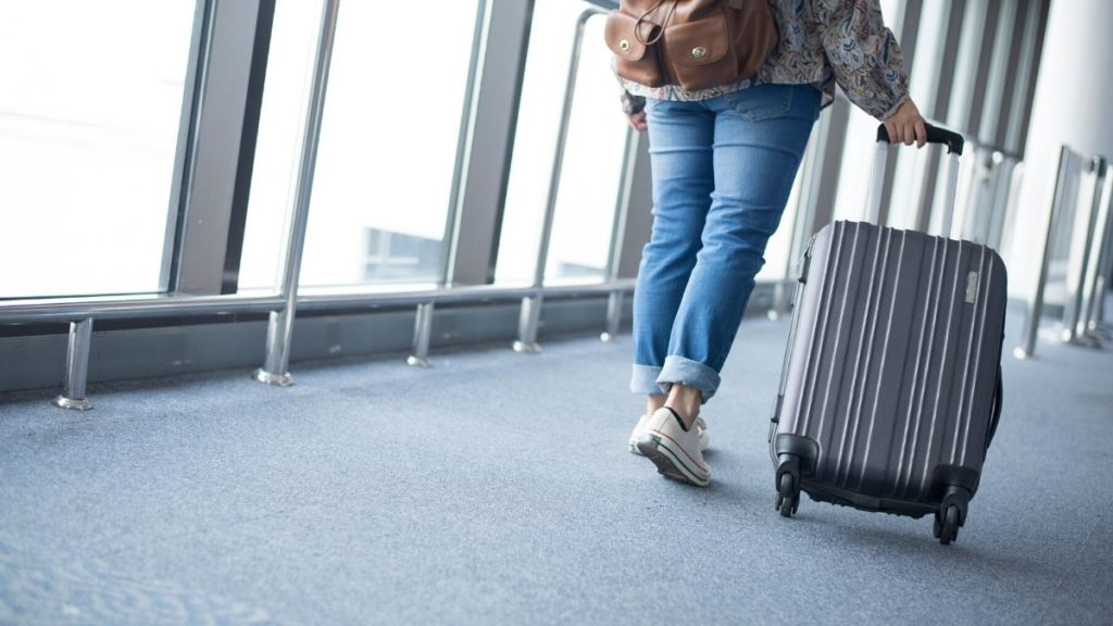 Picture of a lady with a carry on bag