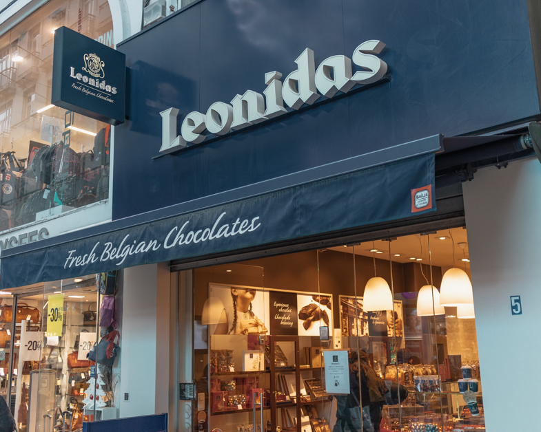 The entrance into Leonidas one of the best places to get Belgian chocolate during a layover in Brussels.