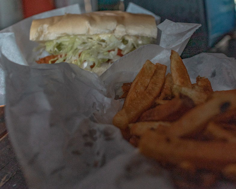 Fried shrimp sandwich and fries from B.O.'S Fish Wagon.