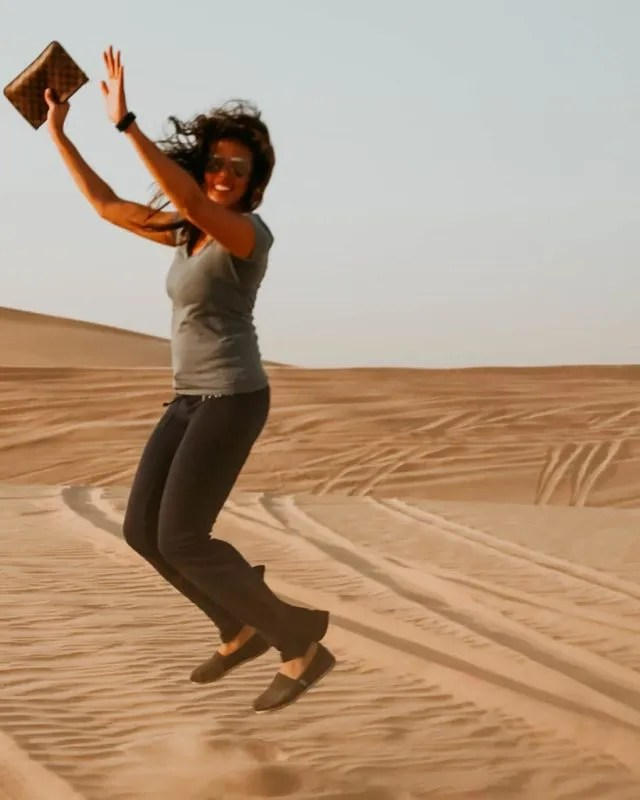 me jumping in the middle of the desert during my Abu Dhabi day trip from Dubai